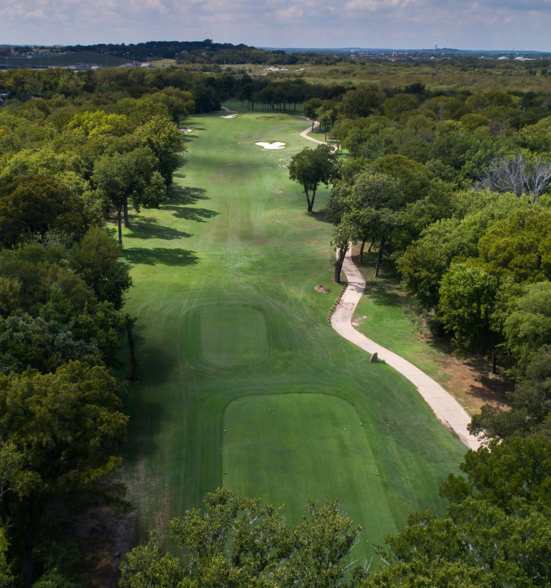 Fairway surrounded by trees at Southern Oaks Golf and Tennis Club