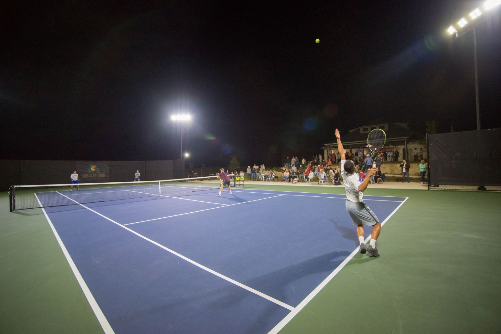 the tennis facility at night at Southern Oaks
